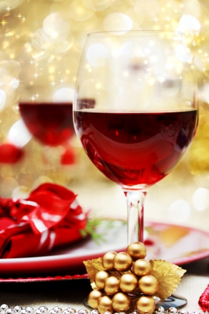 holiday celebration: Decorated Christmas Dinner Table with Red Wine Stock Photo