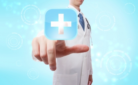 white background: Medical doctor pushing a blue and white medical cross icon over light blue background
