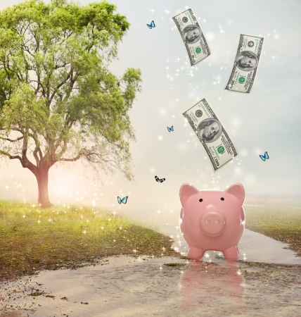 Dollar bills falling in or flying out of a pink piggy bank in a fantasy landscape Imagens