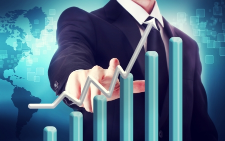 Businessman with graph representing growth  with world map backdrop photo