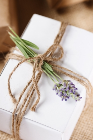 White Present box with rustic twine and sprig of lavender
