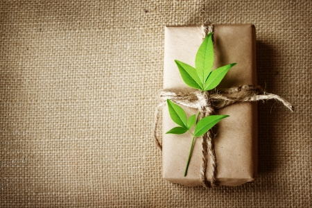 Natural style handcrafted gift box with rustic twine on burlap with copyspace