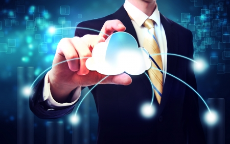 cloud: Business man with cloud computing concept on blue technology background