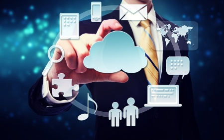 Business man with cloud computing connection concept on blue technology background photo