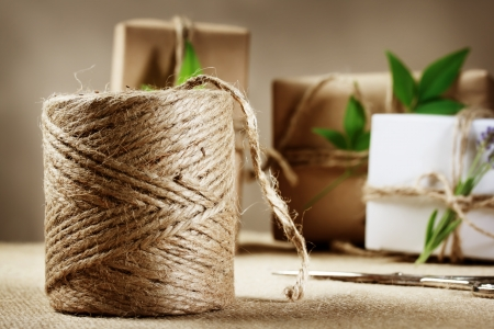 hemp: Rustic hemp cord spool with natural style handcrafted gift boxes Stock Photo