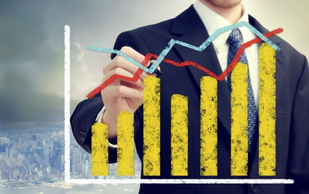 overall: Businessman with bar and line graphs representing overall growth