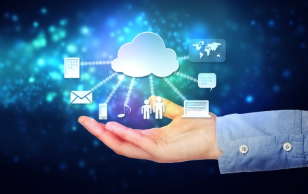 Cloud computing connectivity concept being held in a one persons hand on blue technology background photo