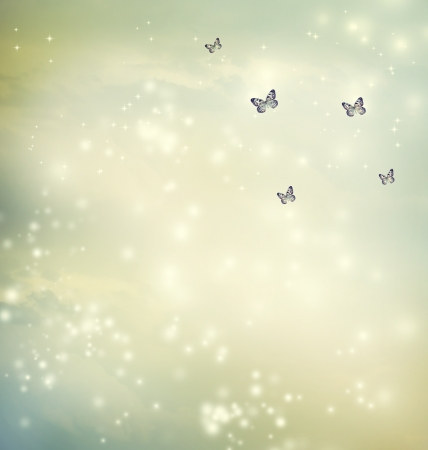 Small butterflies in a fantasy sky