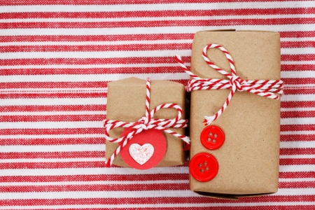 Handmade craft gift boxes on striped cloth photo