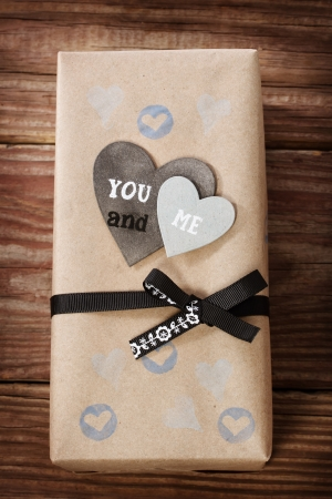 hand crafted: Hand crafted love appreciation present box on rustic wooden table Stock Photo