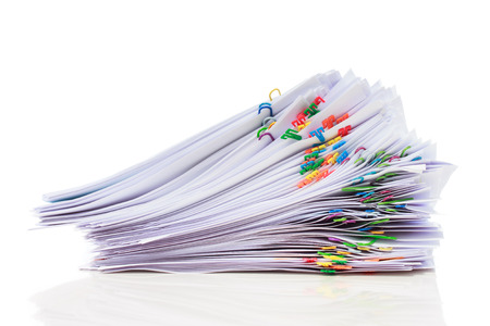 Stack of documents with colorful clips  写真素材
