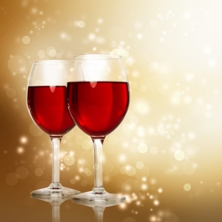 Two Red Wine Glasses on a Gold Sparkling Backdrop Banco de Imagens