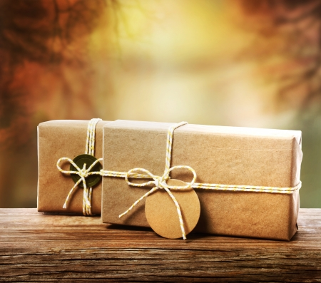 Handcrafted gift boxes with an autumn tree branch