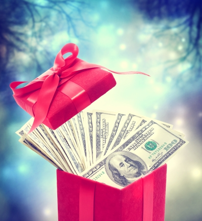 Hundred dollar bills in the red present box at magic night photo