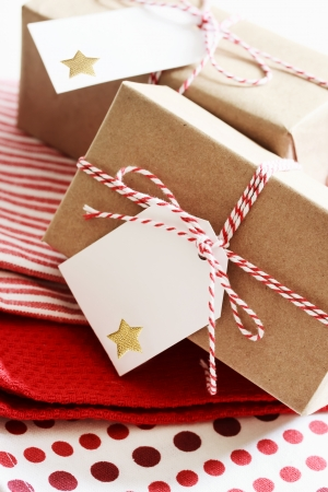 paper craft: Handmade present boxes with tags on red napkins