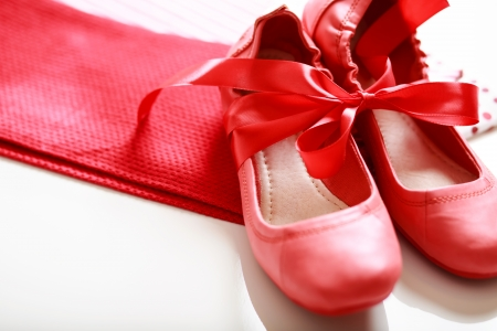 red shoes: Gift wrapped girls red shoes with ribbon  Stock Photo