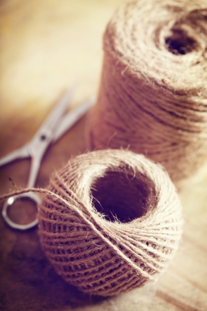 old spools: Natural style twine cord on rustic wooden table
