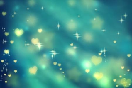 星と青緑背景に黄金の小さな心 写真素材