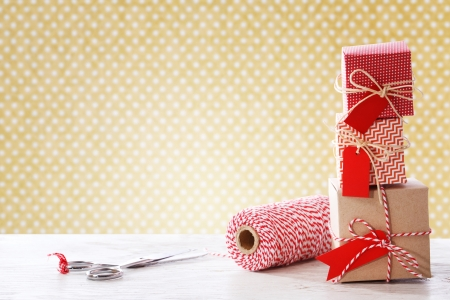 twine: Handmade small boxes with scissors and twine spool on white wooden table