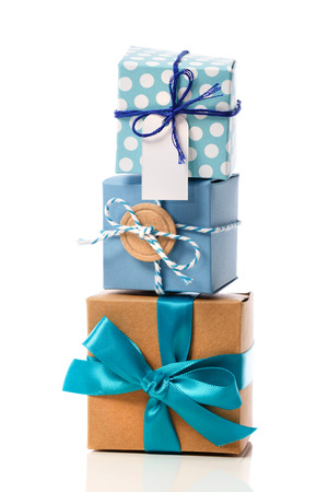 Stack of handcraft blue colored gift boxes on white background