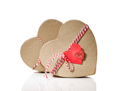 Heart shaped gift boxes with heart tags isolated on white background photo