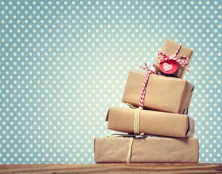 Handmade gift boxes over green polka dots background Stock Photo