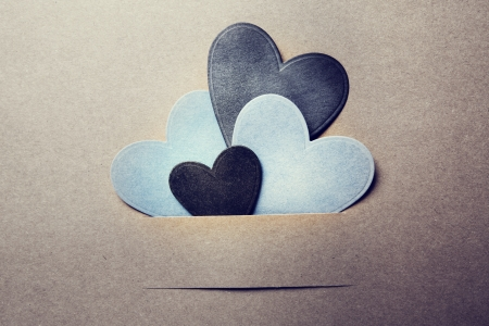 earthy: Paper cut blue and black hearts on earthy colored paper