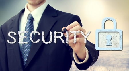 hand writing: Businessman drawing security text and key lock concept  Stock Photo