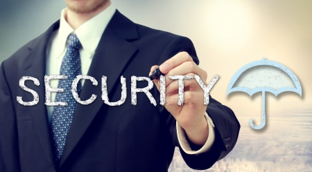 Businessman drawing security text and umbrella picture photo