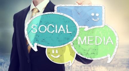 conversation icon: Businessman drawing Social Media colorful speech bubbles
