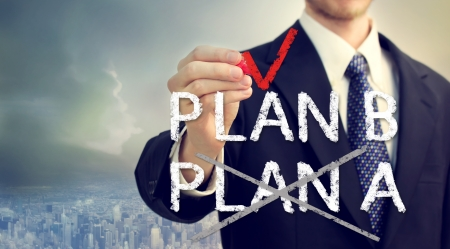 Businessman checking PLAN B over the city skyline background Stock Photo - 25455703