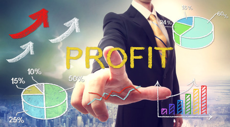 Business man pointing PROFIT with colorful graphs photo
