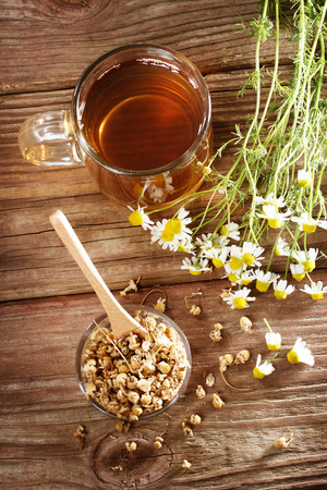 Chamomile herbal tea with dried and fresh chamomile flowers photo