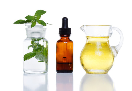 apothecary: Herbal medicine dropper bottle with mint water with oil