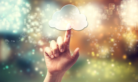 Cloud computing symbol being pressed by a persons hand photo
