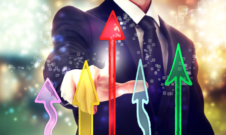 businessman pointing at the rising colorful arrows photo