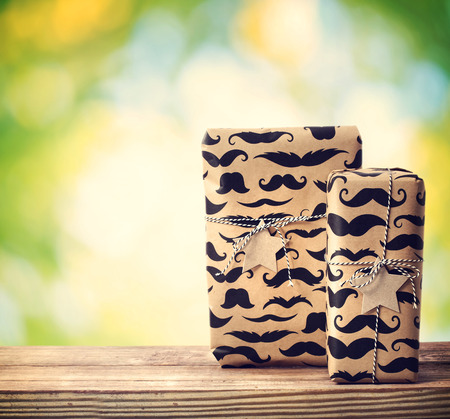 Mustache pattered gift boxes with star shaped tags outside