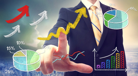 Businessman pointing at rising arrows and graph cartoon photo