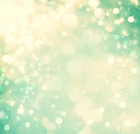 青緑色の光と輝きの光沢のある抽象的な背景