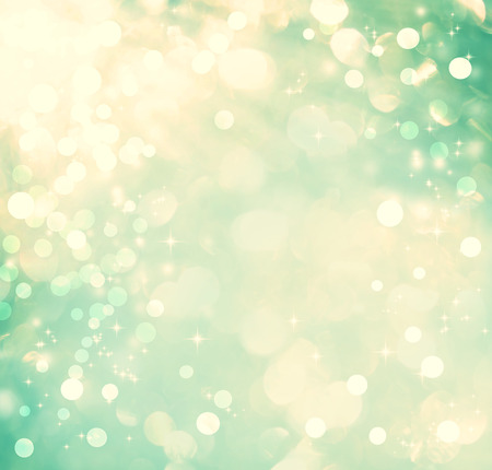 teal background: Teal colored abstract shiny light and glitter background Stock Photo