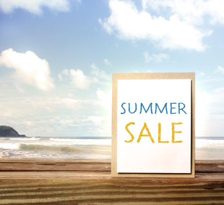 Summer sale sign over blue ocean and sky photo