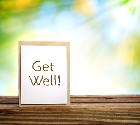 Get well message card over shiny leaves background photo