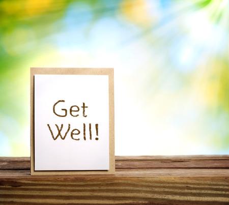 Get well message card over shiny leaves background Reklamní fotografie
