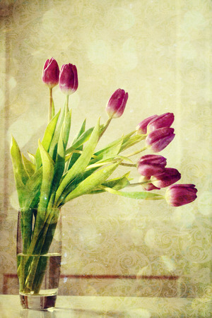 tulips in vase: Beautiful purple tulips in a vase in a vintage style