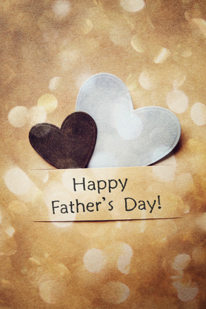 Happy Fathers Day Card with hand-crafted hearts and abstract circle lights photo