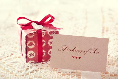 thinking of you: Thinking of you message written on a card with a hand crafted present box