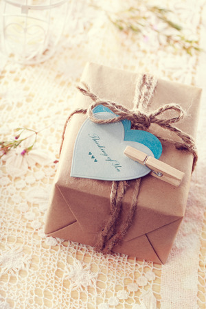 thinking of you: Thinking of you message written on heart-shaped tags and hand crafted present box