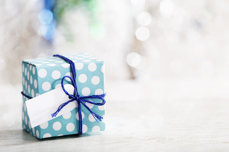 Small handmade gift box over shiny ornaments Stock Photo
