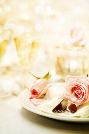 'new year's day': Decorated dinner table with beautiful pink roses