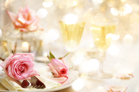 Decorated dinner table with beautiful pink roses photo